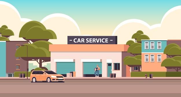 Auto reparatie service concept monteur in uniform repareren band man aan het werk en vaststelling van wiel onderhoud station bouwen horizontale vectorillustratie
