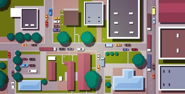 Auto's die de straten van de wegstad met horizontale mening van de gebouwen de hoogste hoek drijven