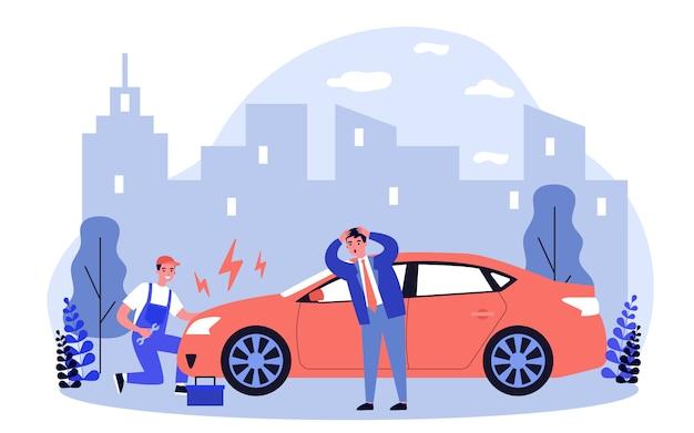 Automonteur die gebroken auto op weg herstelt