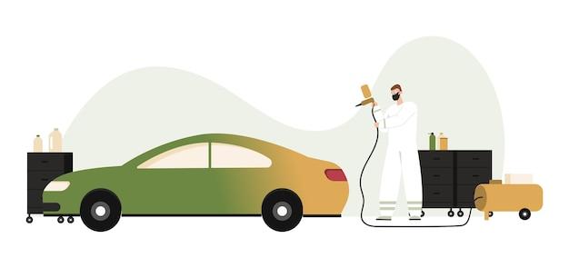Automonteur werken met verfspuitpistool, airbrush schilderij auto.