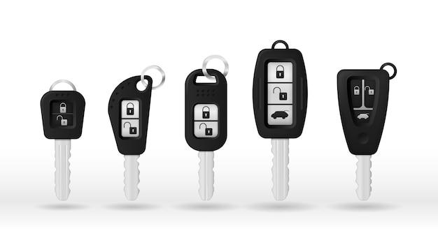 Autosleutels op een witte achtergrond worden geïsoleerd die. autosleutel en alarmsysteem.
