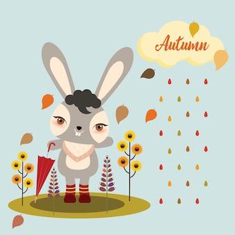 Autumn bunny holding een gevouwen paraplu