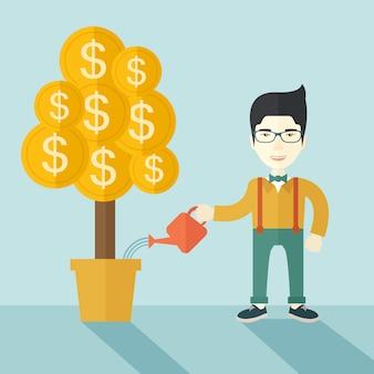 Aziatische zakenman die gelukkig de geldboom water geeft.
