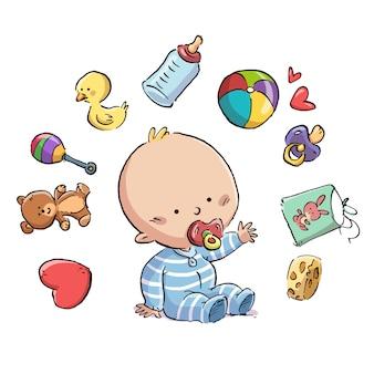 Baby met fopspeen omringd door speelgoed