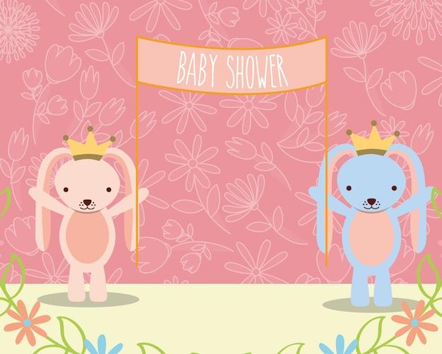 Baby shower roze en blauwe konijntjes met aanplakbiljetbloemen