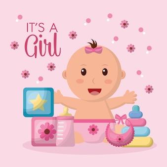 Baby shower viering roze bloemen achtergrond meisje open armen lachend kubussen speelgoed slabbetje