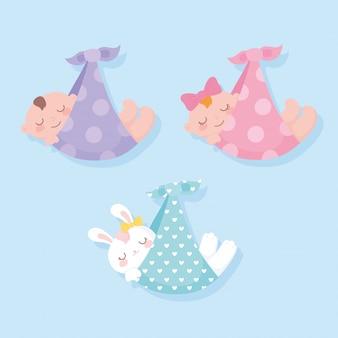 Babydouche, baby's en konijnen op dekens hangen