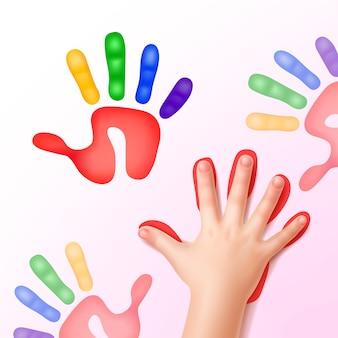 Babyhandje met kleurrijke handafdrukken