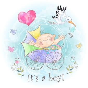 Babyjongen in de kinderwagen.