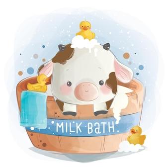 Babykalf dat een melkbad neemt