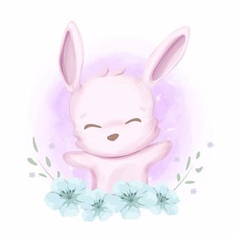 Babykonijn en mooie bloemen