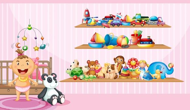 Babymeisje en veel speelgoed in slaapkamer