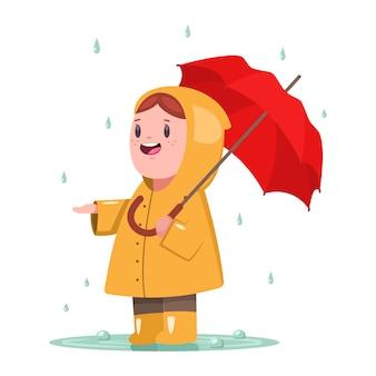 Babymeisje in gele regenjas met paraplu