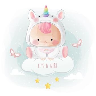 Babymeisje in unicorn-kostuum