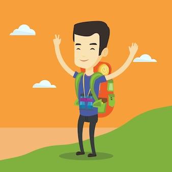 Backpacker met zijn handen omhoog genietend van het landschap.