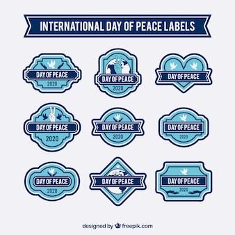 Badges in blauwe tinten voor vrede dag