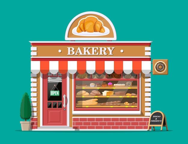 Bakkerij winkel gevel met bord te bouwen. bakwinkel, café, brood-, banket- en dessertwinkel. vitrines met diverse brood- en gebakproducten. markt of supermarkt. vlakke afbeelding