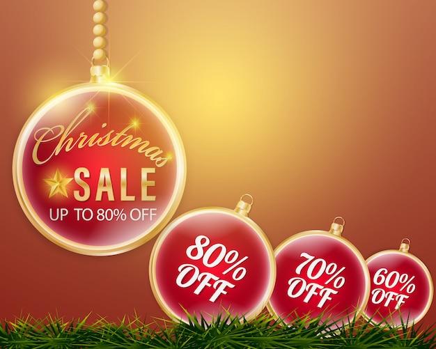 Bal van kerstmis opknoping banner met procent korting prijskaartjes op rode achtergrond.