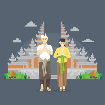 Balinese paar namaste groeten voor poort