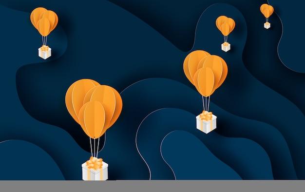 Ballon geel zwevend en geschenkdoos