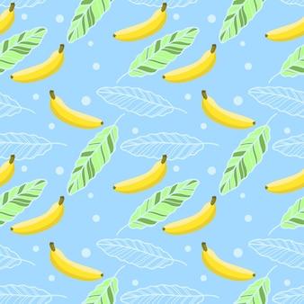 Bananenbladeren en bananen op blauwe achtergrond.