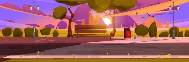 Bank in het landschap van de parkzomer bij zonsondergang