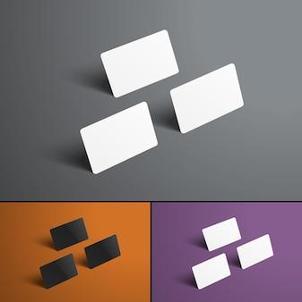 Bankkaarten die op grijs, oranje en paars zweven