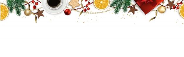 Banner met kerstboomtakken, kerstballen en ruimte voor tekst.