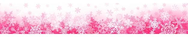 Banner van complexe kerstsneeuwvlokken met naadloze horizontale herhaling, in roze kleuren. winterachtergrond met vallende sneeuw Premium Vector
