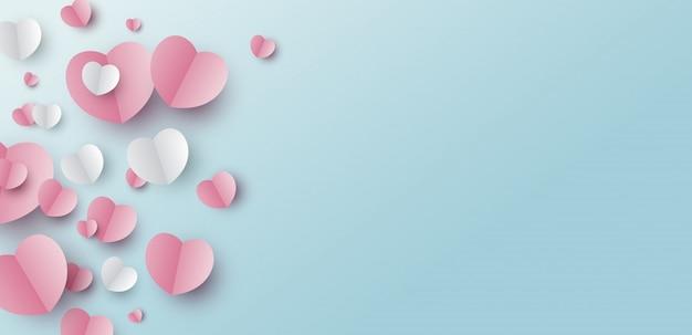 Bannerontwerp van papier harten op blauwe achtergrond
