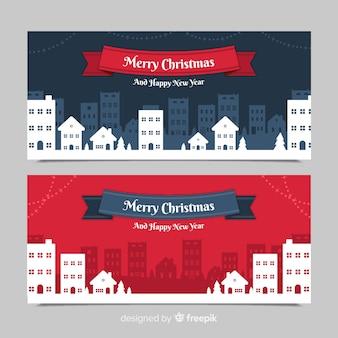Banners in platte ontwerp met kerststad