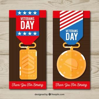 Banners met veteranen dag badges in plat ontwerp