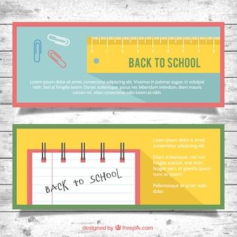 Banners voor de school met een liniaal en een notebook
