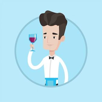 Barman die een glas wijn in hand houdt.
