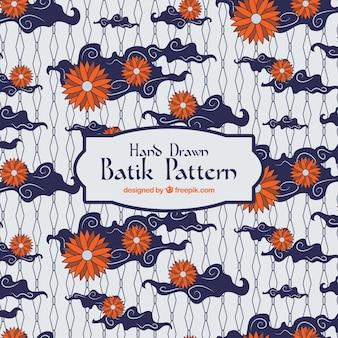 Batik patroon met bloemen en wolken