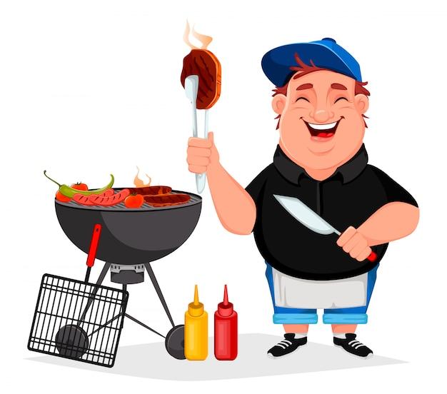 Bbq. jonge vrolijke man kookt gegrild voedsel