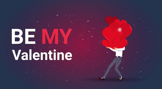 Be my valentine greeting card man met stapel harten love day vakantie concept