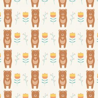 Bear cartoon en bloemen naadloze patroon behang