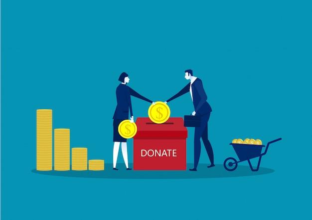 Bedrijf gooit gouden munten in een doos voor donaties.