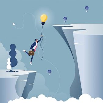 Bedrijfsconcept creativiteit met zakenman vliegen met gloeilamp ballon