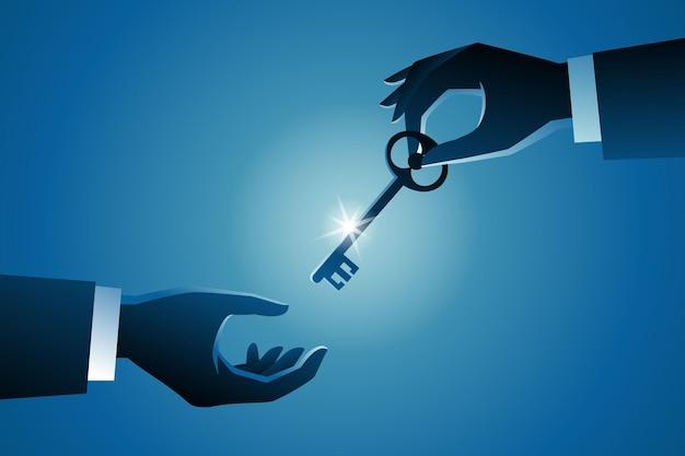 Bedrijfsconcept, hand die een sleutel geeft aan de andere hand
