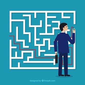Bedrijfsconcept met labyrint en zakenman