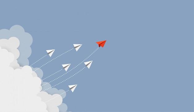 Bedrijfsconcept. rode papieren leider vliegtuig vliegen