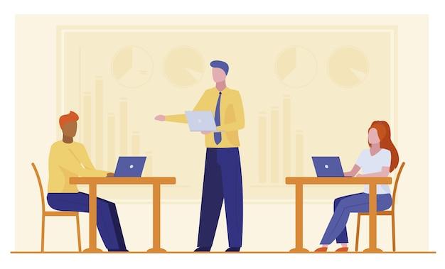 Bedrijfsleider die werkgroep instrueert