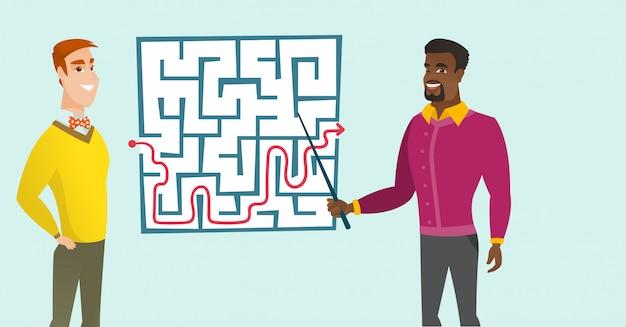 Bedrijfsmensen die labyrint met oplossing bekijken.