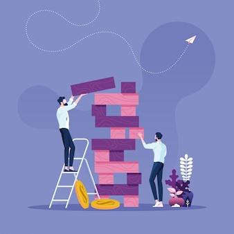 Bedrijfsrisicoconcept twee zakenlieden die het torenspel spelen