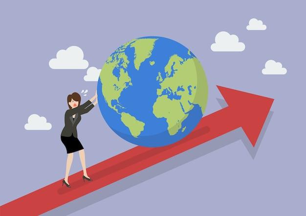 Bedrijfsvrouw die de wereld op grafiek omhoog duwen