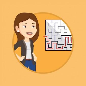 Bedrijfsvrouw die labyrint met oplossing bekijken