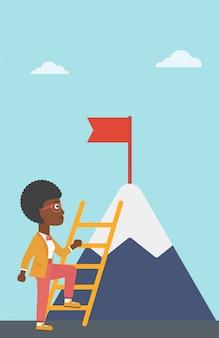 Bedrijfsvrouw die op berg beklimmen.