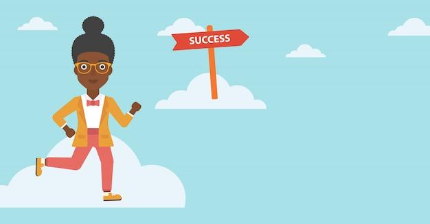 Bedrijfsvrouw die zich aan succes bewegen.